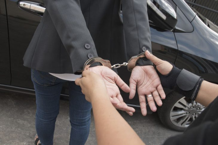 Young women arrested and with handcuffs