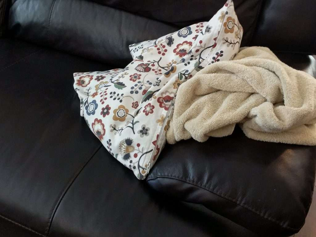 pillow and towel on a leather chair
